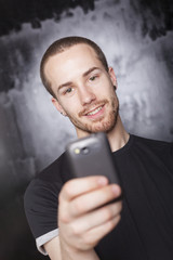 Smiling Man use smartphone