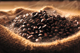 Fototapety Coffee beans with smoke in burlap sack