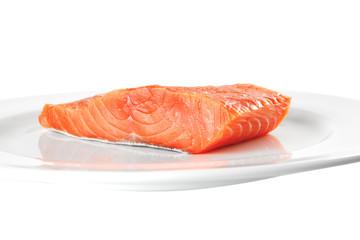 pink smoked salmon on white plate