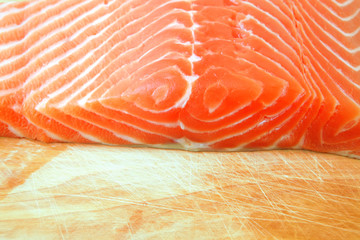 salmon fish piece over wood