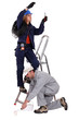 electrician on a ladder and painter working