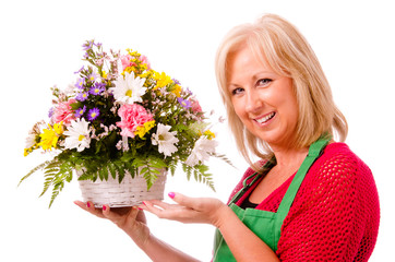 Portrait of smiling happy florist with flower arrangement