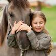 Leinwandbild Motiv Horse whispers - Horse and lovely girl - best friends