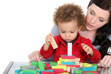 Woman and child playing with wooden blocks