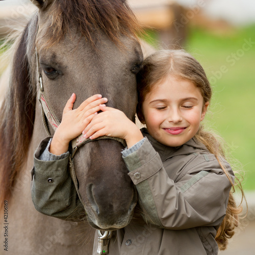 canvas print picture Horse whispers - Horse and lovely girl - best friends