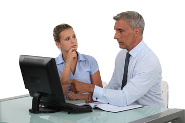 businessman and assistant analyzing data and discussing