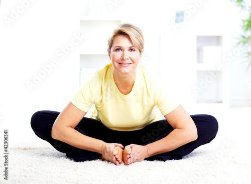 Leinwandbild Motiv Senior woman doing yoga.