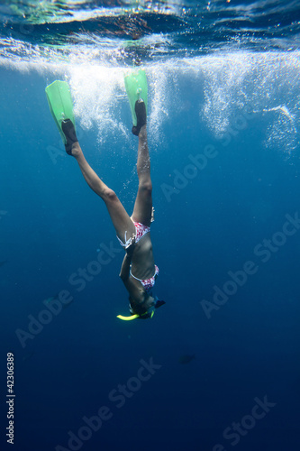 Young woman diving