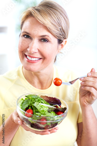 Senior woman with a salad. Diet.