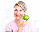 Fototapety Senior woman with apple. Diet.