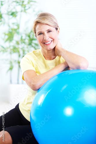Papiers peints Fitness Senior woman doing yoga.