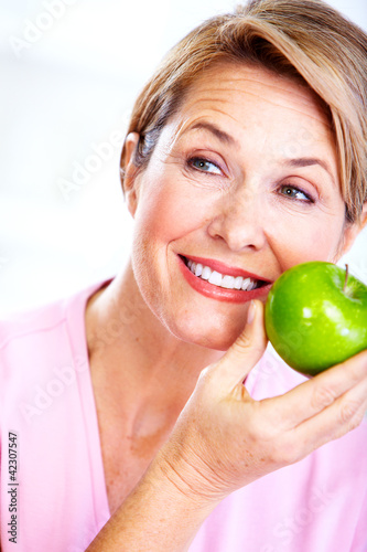 Senior woman with apple. Diet.