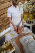 Woman head massage at luxury spa centre