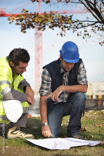 Construction workers discussing plans