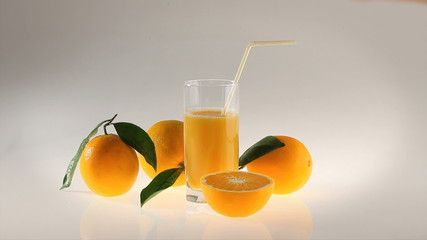 natural Orange juice in glass with straw