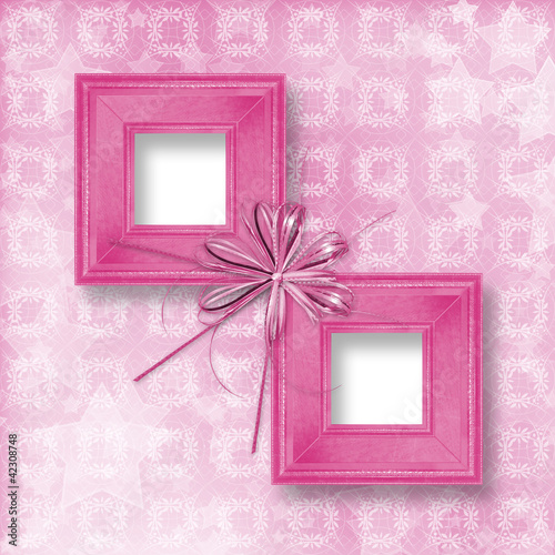 Old pink wooden frames Victorian style with bow and ribbons