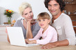 Family using a laptop computer
