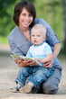 Mother with son reading a book