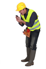 Angry builder shouting into telephone