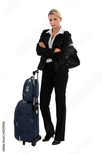 Blond businesswoman with luggage