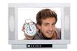 Man holding alarm clock inside television