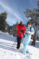 Retired couple cross-country skiing