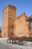 Wall of Warsaw castle and empty bench