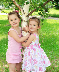 Portrait of two cute little girls