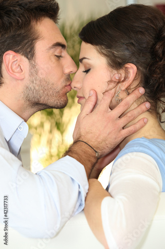 Man kissing woman's nose