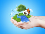 Fototapety Hands holding clear green meadow alternative energy concept