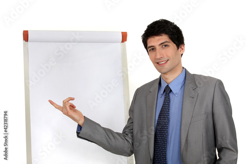 handsome executive pointing at board