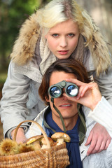 Couple with shopping and binoculars
