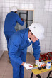 Plumber marking and cutting pipe