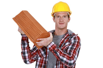 Roofer with tiles