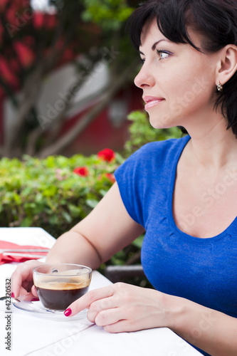 Happy woman drinking coffee