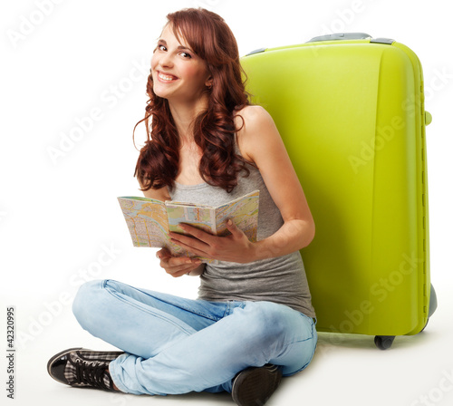 Happy girl with map and luggage