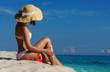 Slim woman applying sunscreen