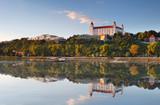 Fototapety Bratislava castle with reflection in river Danube - Slovakia