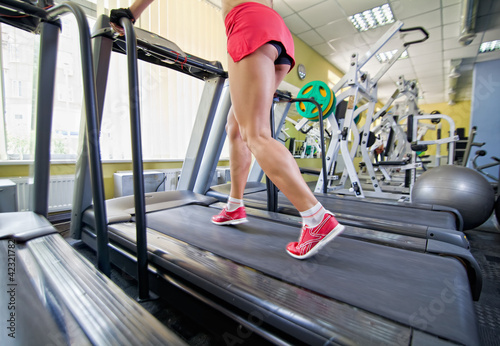Close up of female legs on a treadmill