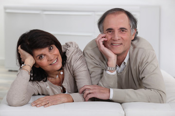 Middle-aged couple lying on a futon