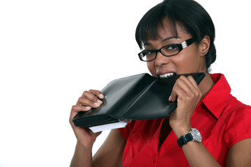 Woman biting her personal organizer