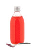 medicine bottle with red syrup and spoon isolated on white backg