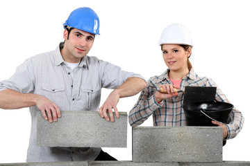 Man and woman building a house