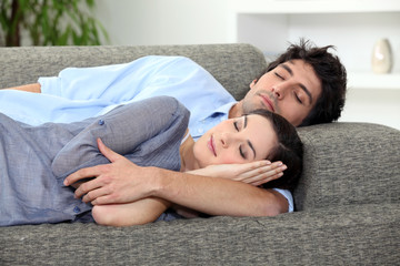 Couple asleep on sofa