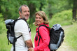 Portrait of smiling hikers in forest pathway