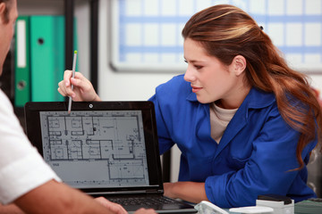 female plumber with customer