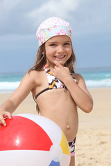 Young girl in a bandana with a beach ball