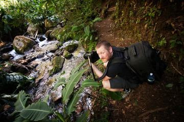 Photographer at a Stream