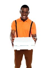 Pizza boy delivering an order