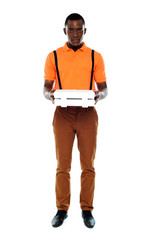 Full length portrait of delivery boy with pizza